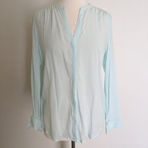 Mint blouse with gathered shoulders